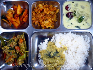 Rice with Paruppu Curry, Vellarika Pulissery, Potato Fry, Aviyal and Onion Papada Thoran