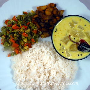 Rice with Vellarika Pulissery, Potato Fry and Beans Carrot Poriyal