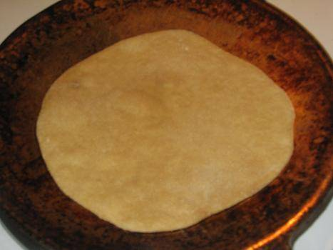 Place rolled out roti on hot tawa