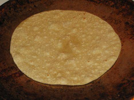 Partially fry the roti on both sides